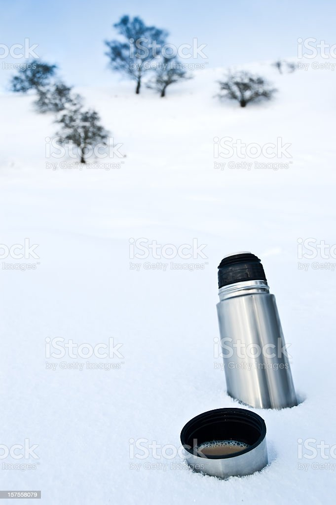 Coffee Flask in the Snow stock photo