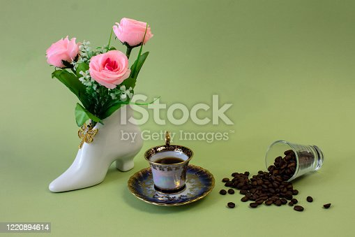 927814202 istock photo coffee, flowers, candles on a pistachio background as a symbol of home warmth and coziness, beauty and a wonderful morning 1220894614
