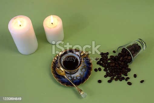 927814202 istock photo coffee, flowers, candles on a pistachio background as a symbol of home warmth and coziness, beauty and a wonderful morning 1220894649