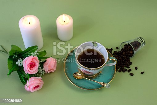 927814202 istock photo coffee, flowers, candles on a pistachio background as a symbol of home warmth and coziness, beauty and a wonderful morning 1220894669