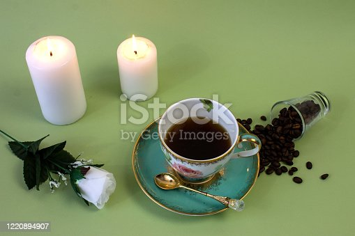 927814202 istock photo coffee, flowers, candles on a pistachio background as a symbol of home warmth and coziness, beauty and a wonderful morning 1220894907