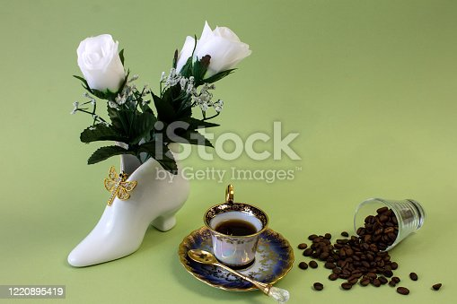 927814202 istock photo coffee, flowers, candles on a pistachio background as a symbol of home warmth and coziness, beauty and a wonderful morning 1220895419