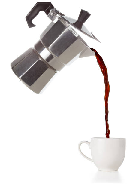 coffee flowing out of a flying moka coffee poured from a flying moka into a cup isolated on white pouring stock pictures, royalty-free photos & images