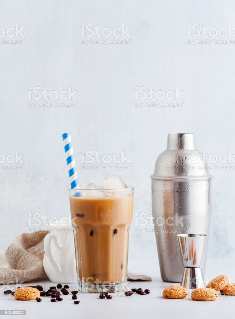 Coffee frappe in a tall glass with ice . and Amaretti cookies stock photo