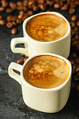 coffee freshly brewed in a white cup serving of beverage (coffee grain)