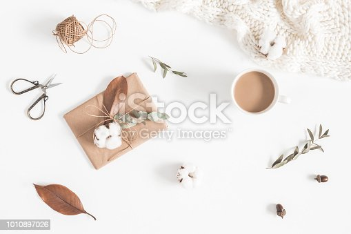 istock Coffee, gift, autumn leaves, knitted blanket. Flat lay, top view 1010897026