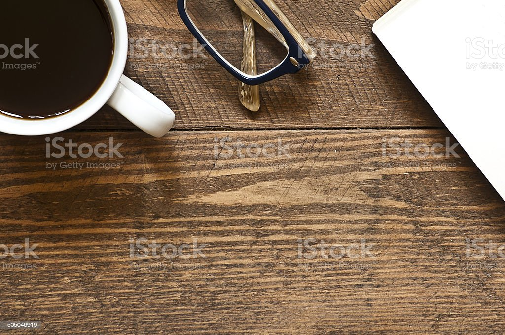Coffee, Glasses and book on wooden table stock photo