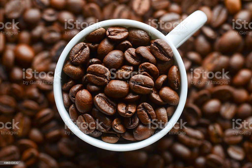 coffee grains in a white mug stock photo