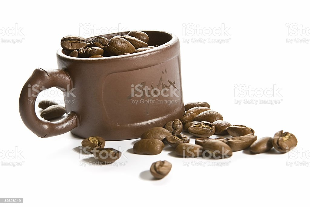 Coffee grains in brown cup royalty-free stock photo