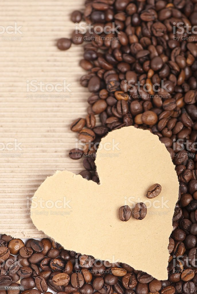 coffee grains on paper the form of heart royalty-free stock photo