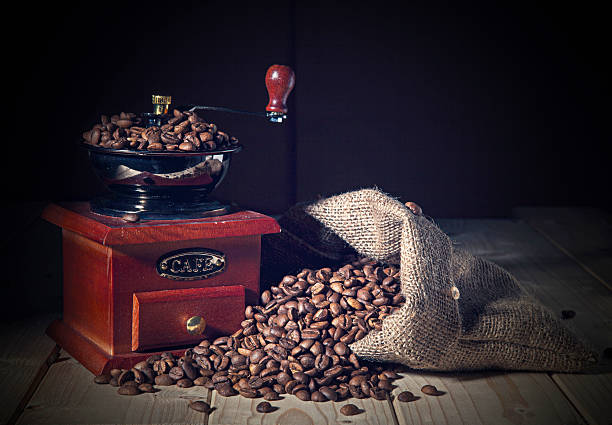 Coffee Grinder and beans with sack stock photo