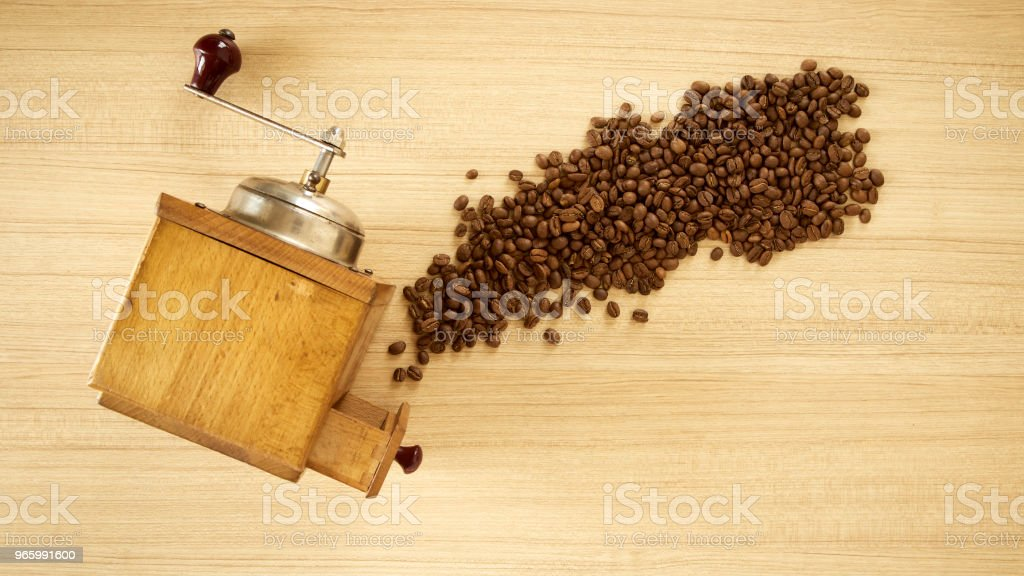 Coffee grinder with coffee beans on wooden background - Royalty-free Breakfast Stock Photo