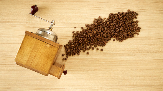 Coffee Grinder With Coffee Beans On Wooden Background Stock Photo - Download Image Now