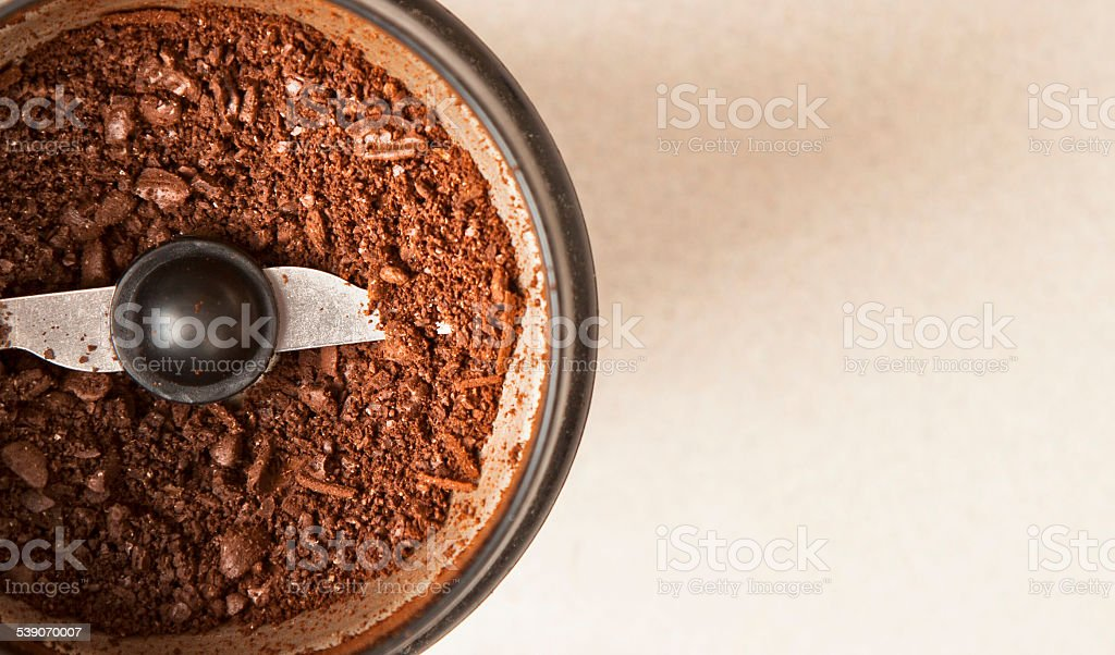 Coffee grinder with ground beans stock photo