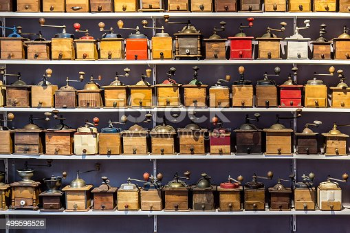coffee grinders aligned in rows on store shelves, flea market Saint ouen, Paris, France