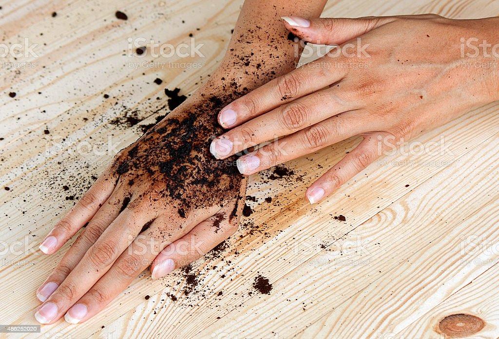 coffee hand scrub with ground coffee (wet) stock photo