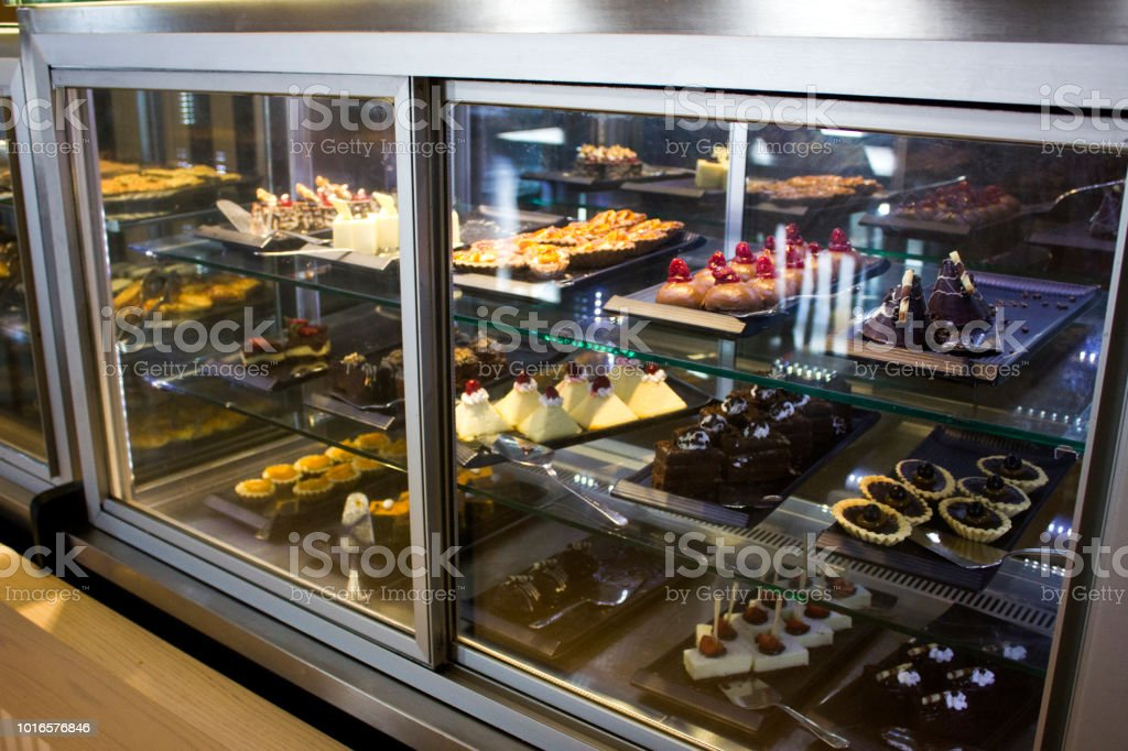 Coffee house with variety of crockery, pastries and cakes in the storefront stock photo