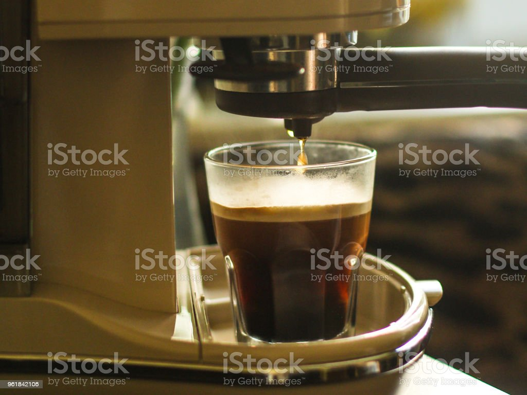 coffee in a coffee machine (a portion of fresh coffee) stock photo
