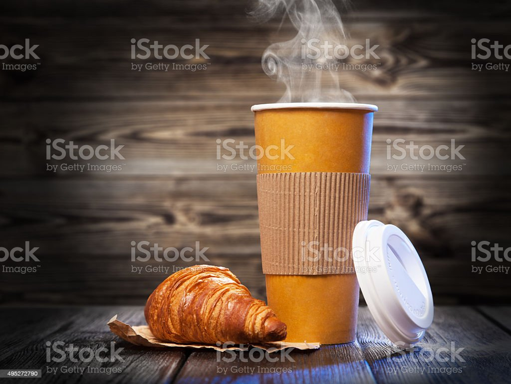 Coffee in a paper cup stock photo