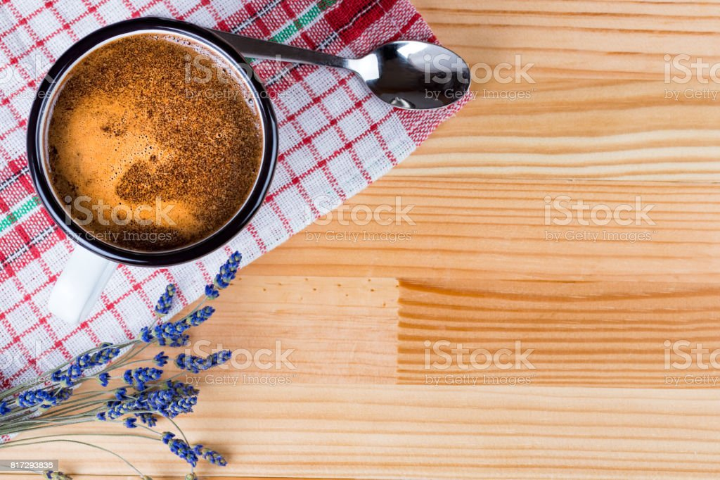 Coffee in a vintage metal mug, lavender and spoon. stock photo