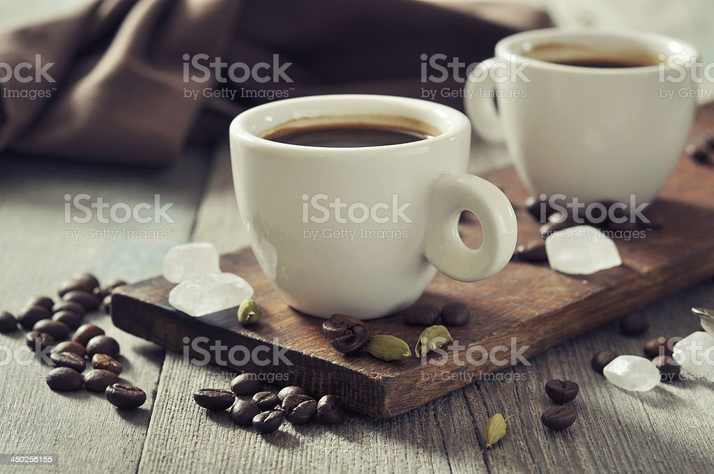 Coffee in cups with cardamom stock photo