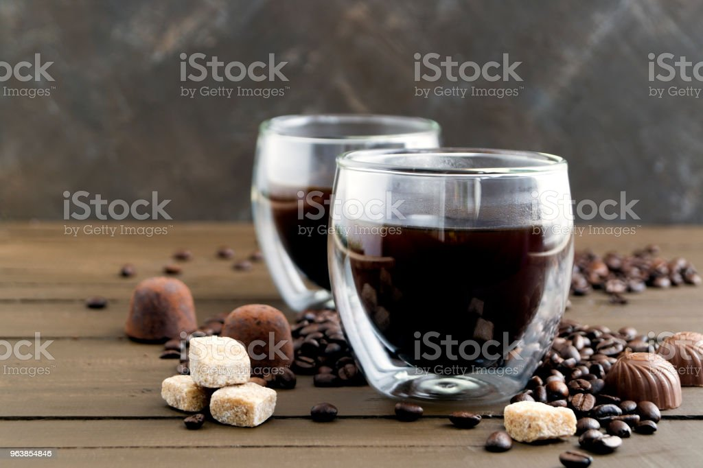 Coffee in double-walled glass on a wooden table. - Royalty-free Breakfast Stock Photo
