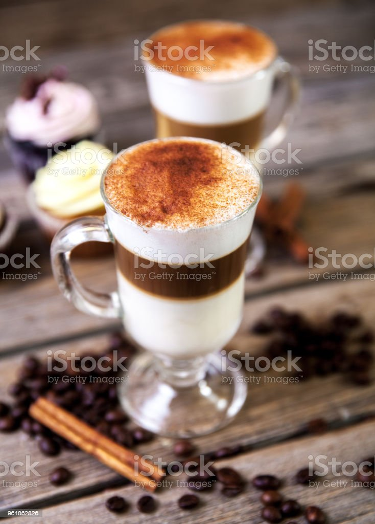 Coffee in glass on the wooden background royalty-free stock photo