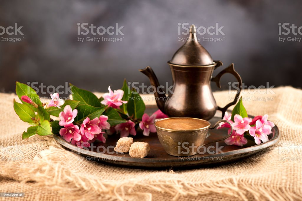 Coffee in oriental style and flowers stock photo
