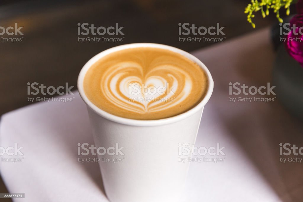 Coffee in Paper Cup with Heart Design stock photo