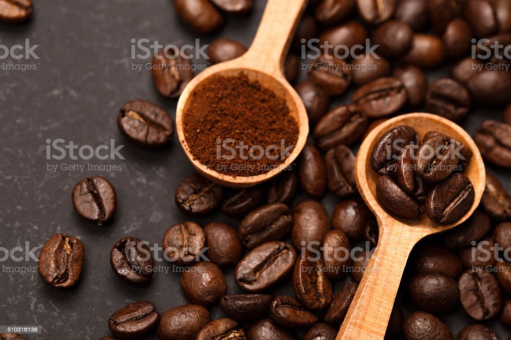 Coffee in two conditions: ground and beans stock photo