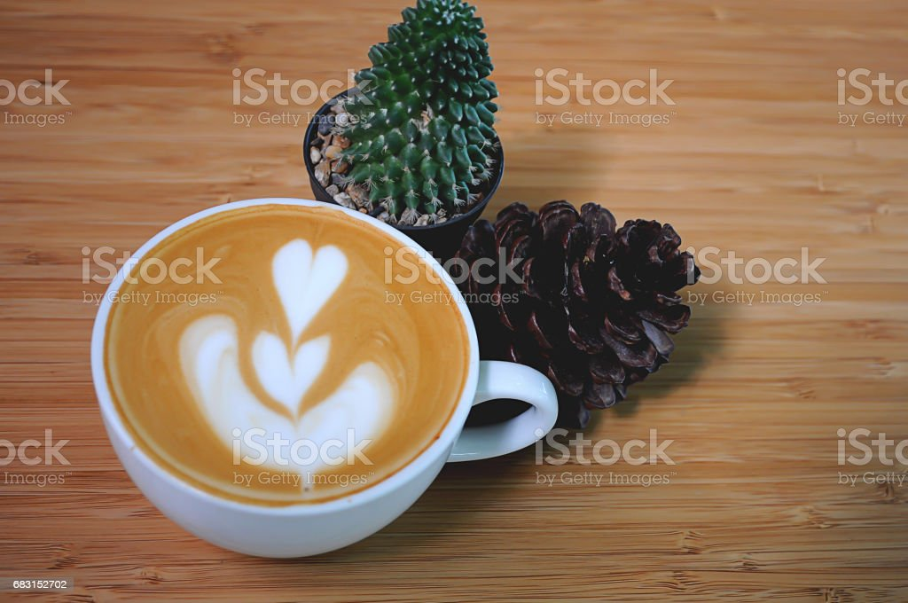 Coffee in white cup and cactus on wooden table 免版稅 stock photo