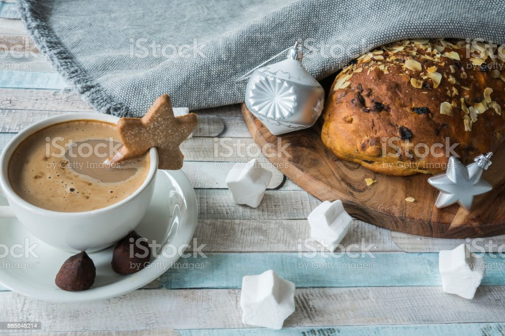 coffee in white cup and saucer, with typical Dutch and German Christmas bread, kerststol stock photo