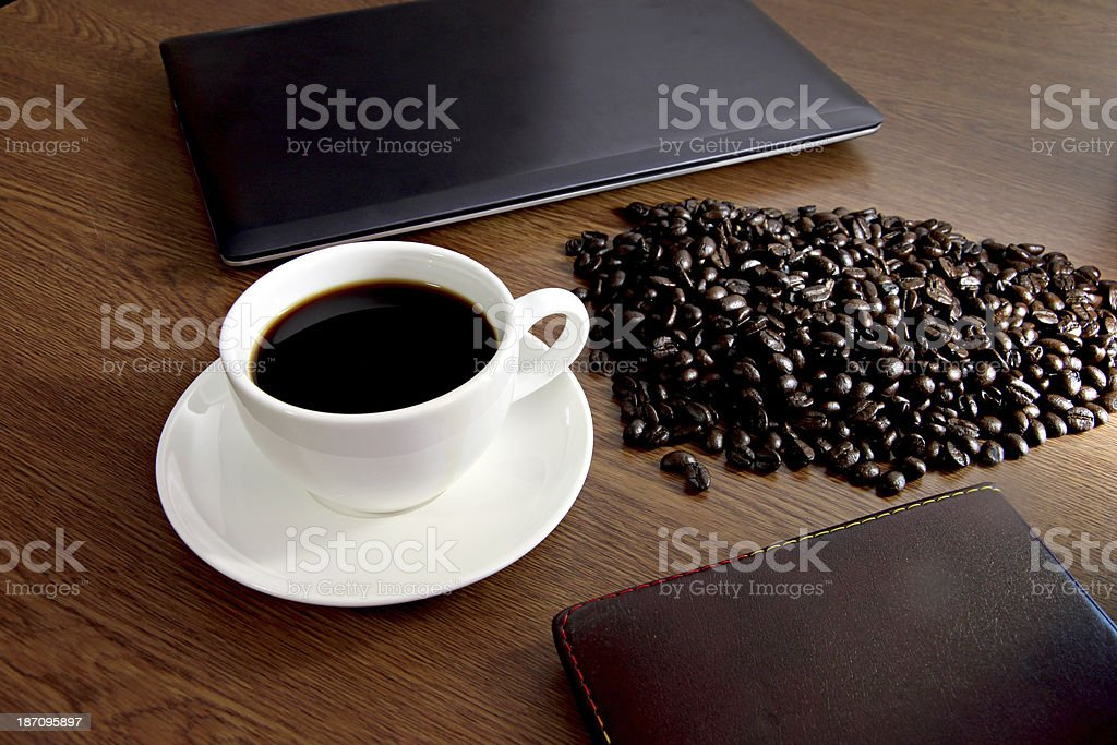 Coffee in white cup on old wooden desk. royalty-free stock photo
