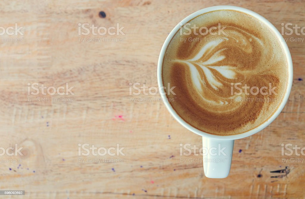 Coffee in white cup on wood table in coffee shop. royalty-free stock photo