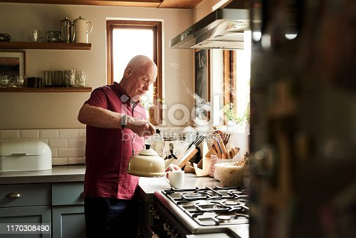 Cropped shot of a senior man preparing a hot beverage at home