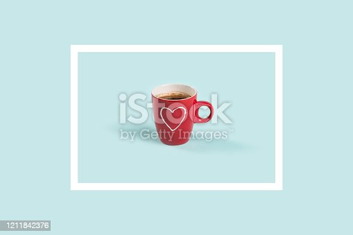 Pattern made of framed red coffee cup on a blue background.