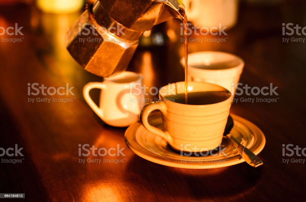 Coffee is poured in a cup in the morning. royalty-free stock photo