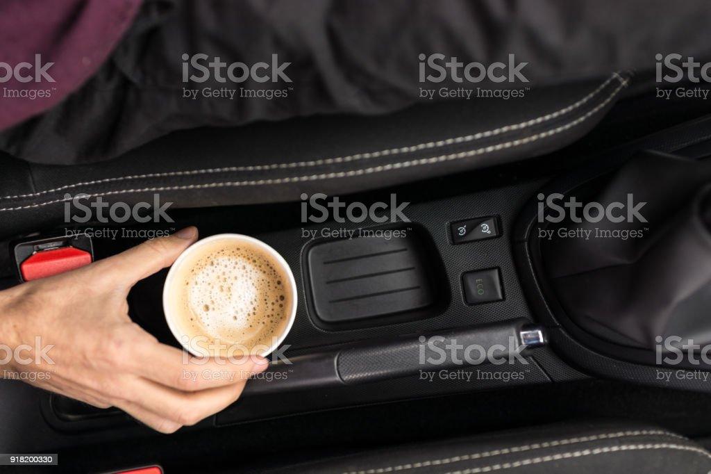 Coffee keeps him going stock photo