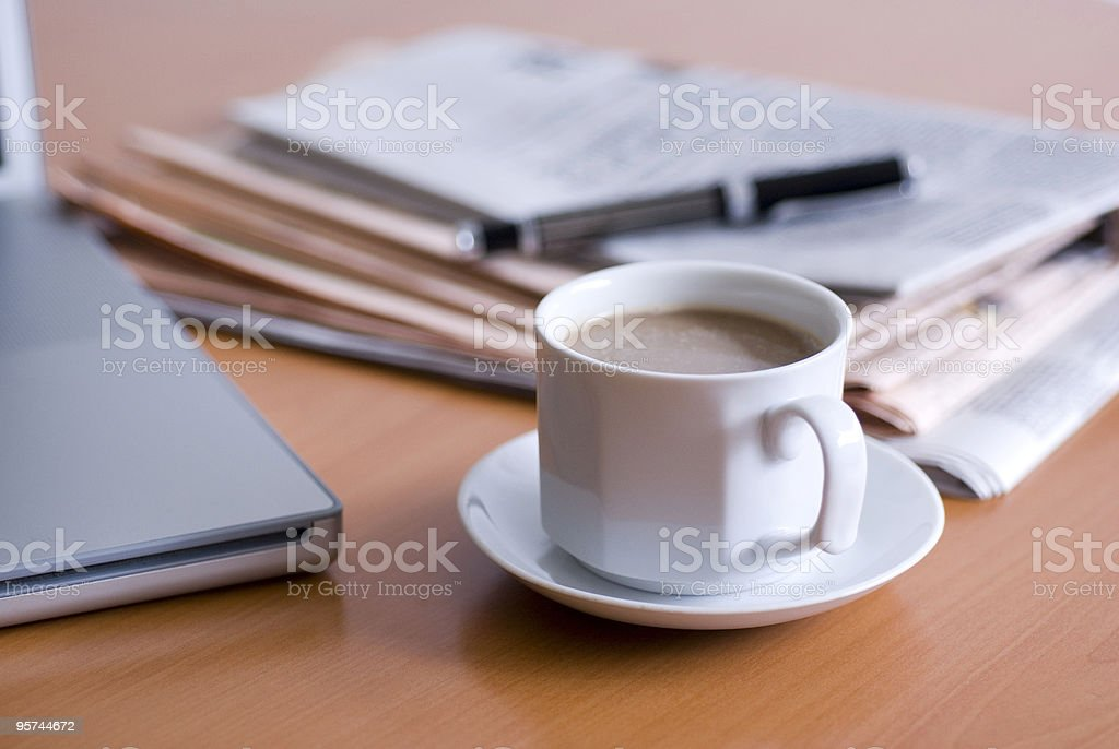 Coffee, laptop, newspaper and a fountain pen on table royalty-free stock photo