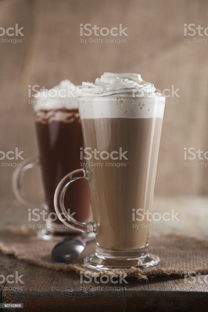 Coffee Latte and Hot Chocolate with whipped cream old wooden royalty-free stock photo