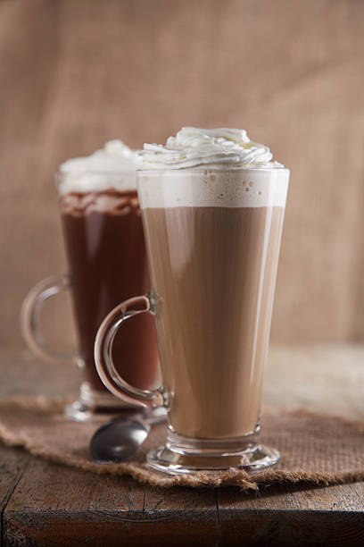 Coffee Latte and Hot Chocolate with whipped cream old wooden stock photo