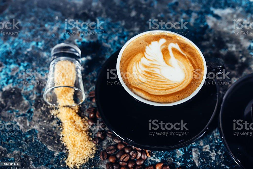 Coffee latte art, barista and bartender creating machiatto coffee stock photo