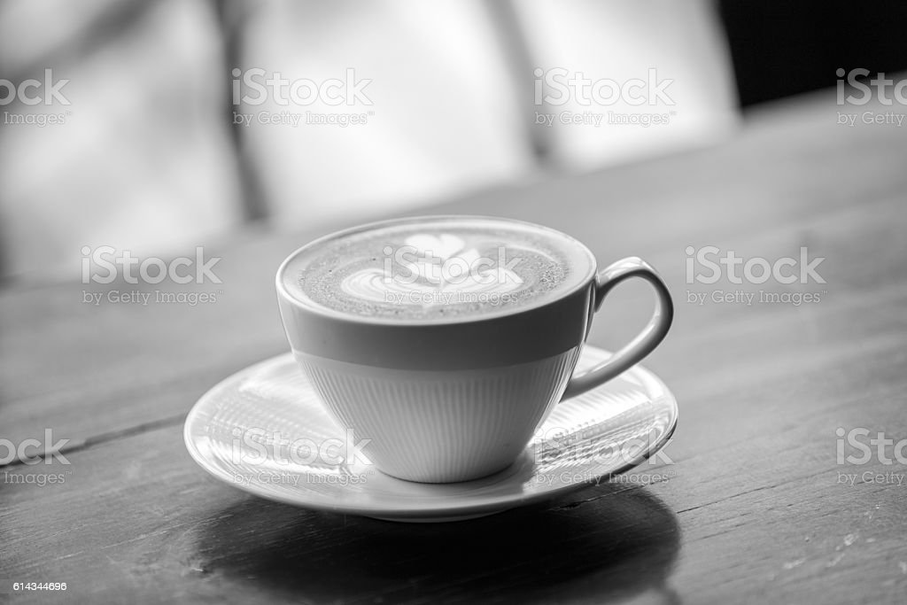 Coffee latte art on the wood desk at coffee shop. Black & White