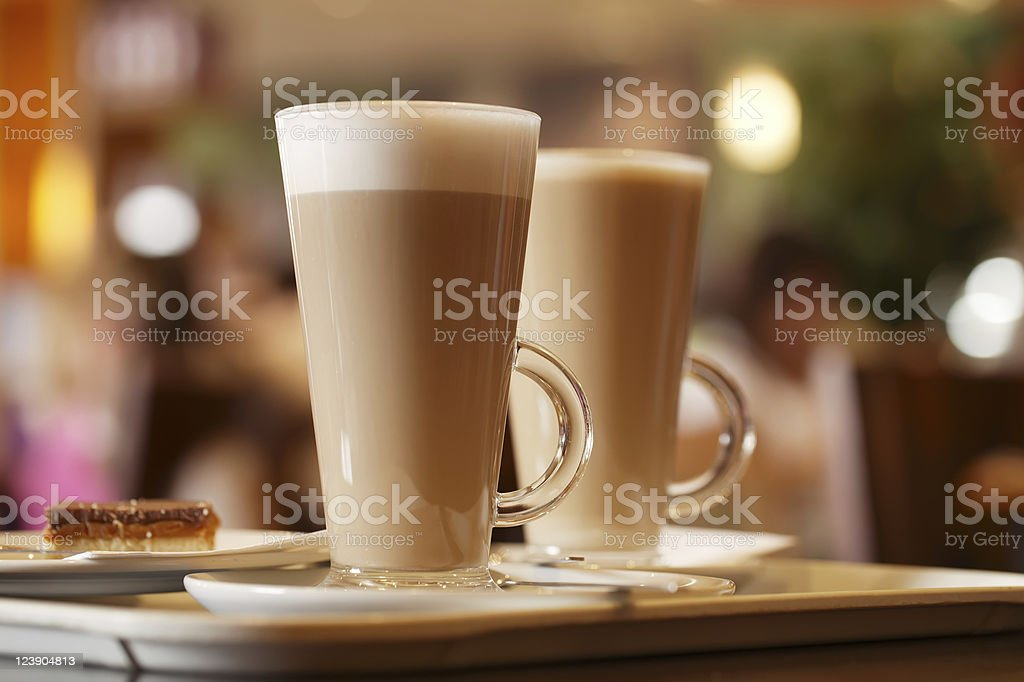 coffee latte in two tall glasses inside royalty-free stock photo