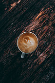 Coffee Latte on Rustic Wooden Background