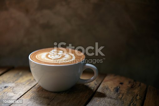 Coffee latte on wooden table