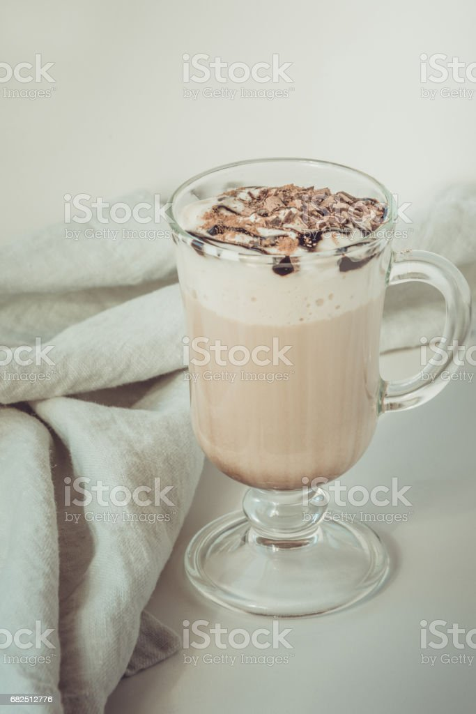 Coffee latte with thick foam and grated chocolate in glass. Vintage toned. foto de stock libre de derechos