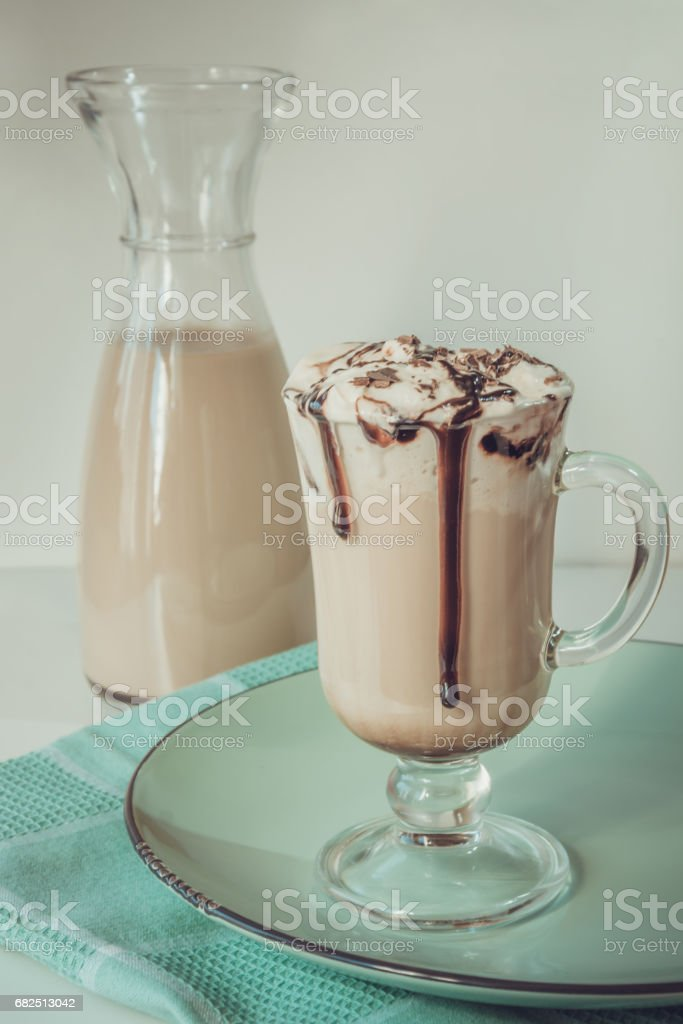Coffee latte with thick foam and grated chocolate in glass. Vintage toned. Стоковые фото Стоковая фотография