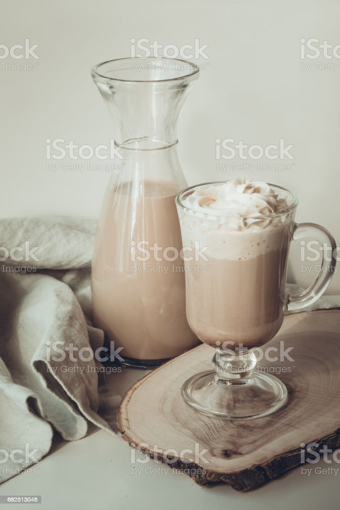 Coffee latte with thick foam and grated chocolate in glass. Vintage toned. royalty-free stock photo