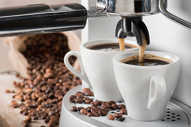 coffee machine and coffee beans - coffee maker stock pictures, royalty-free photos & images